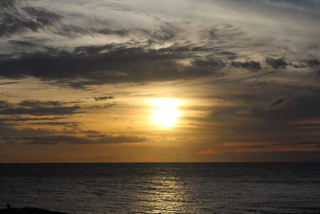 Sunset over the ocean during our Maui family vacation.