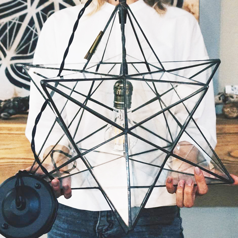 Looking for modern farmhouse light fixtures? Well, these five beauties are the real deal as they were all handmade! Like this glass star pendant by GEOMETRICGLASSplace.
