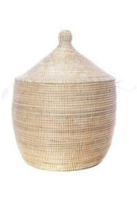 Love the look of bohemian bedroom decor, but need a little guidance pulling it all together? Check out this boho bedroom shopping guide - featuring eco-conscious items like this handmade grass basket from ethical marketplace Made Trade.
