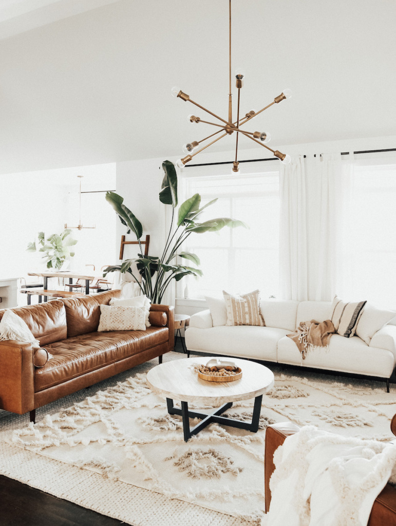 Here's how to create a modern boho living room, which balances the funky boho vibe with clean lines and neutral colours - like this one featured on The Every Mom.