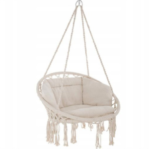 Here's how to create a modern boho living room, which balances the funky boho vibe with clean lines and neutral colours - and features beautiful furniture like this hanging chair.